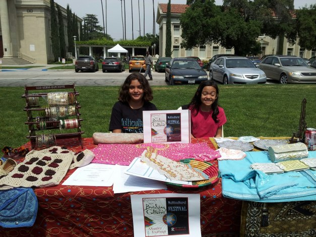 Helpers at the table. Artifacts were from India, Pakistan, Morocco.