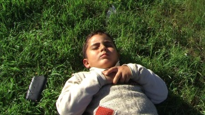 image of a young boy lying on the grass