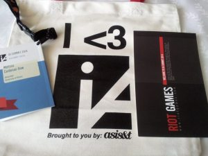Image of tote bag, invitation, program book, and lanyard for IASummit14 attendees.