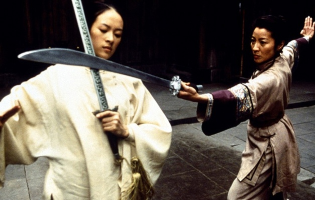 Film still from Crouching Tiger, Hidden Dragon, 2000. It depicts the characters Jen and Yu Shu-Lien crossing swords in a duel.